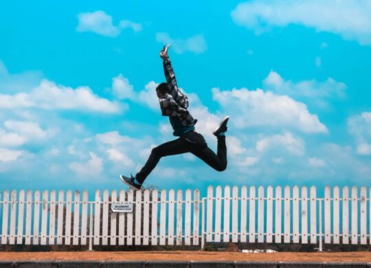 man-jumping-over-white-fence-1030794